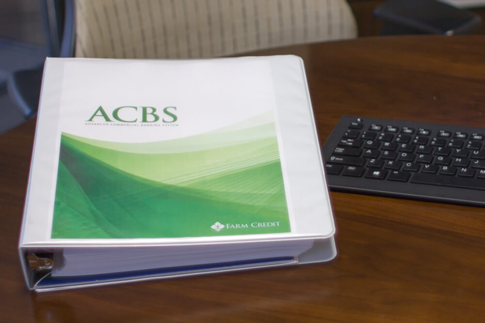 ACBS binder on table