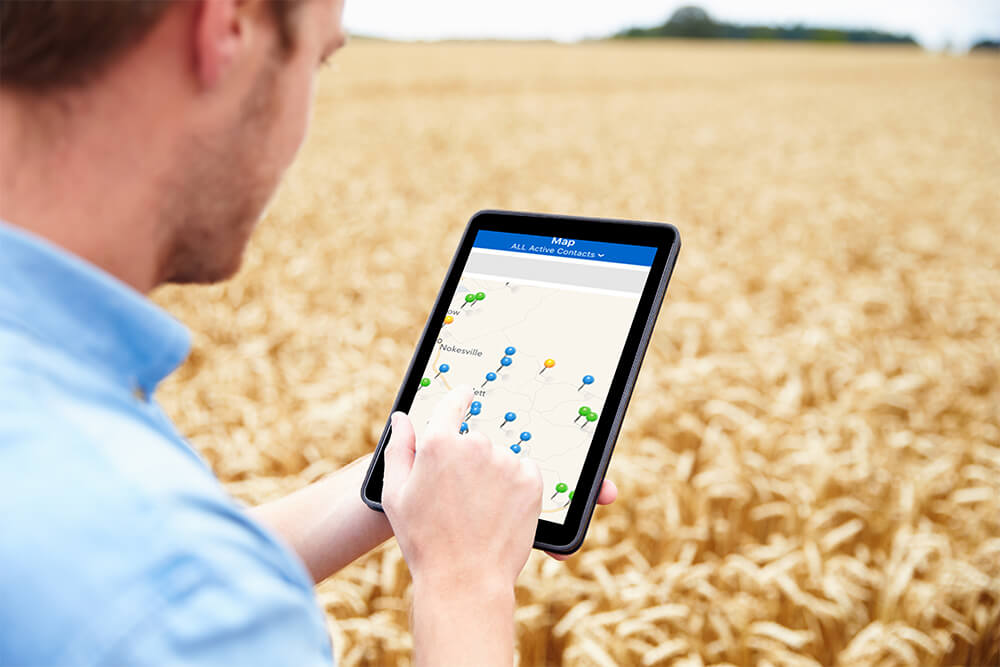 Man using his tablet in a field