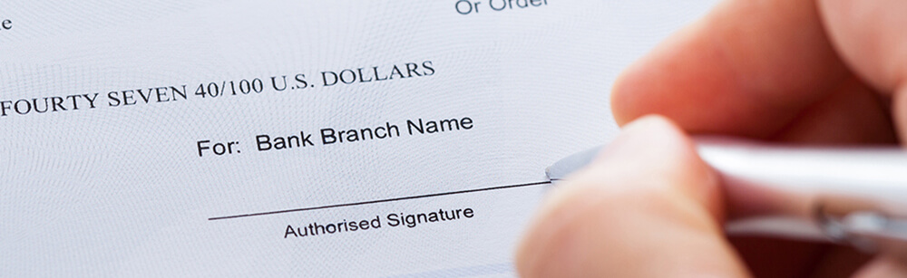 Person signing a check